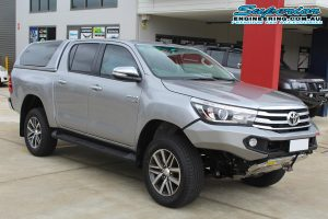 Front right view of the Silver Toyota Hilux Revo after being fitted with a 2 inch Bilstein lift kit at the Superior Engineering Deception Bay car park