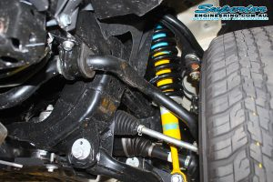 Closeup view of a single Bilstein strut and coil springs fitted to the current model Toyota Hilux Revo four wheel drive