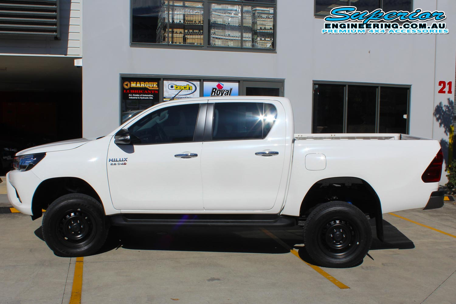 Left side view of a dual cab Toyota Hilux Revo fitted with a complete 3 inch Superior Nitro Gas lift kit