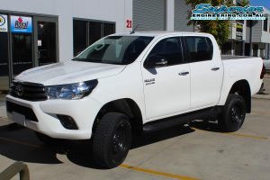 Front left view of a white dual cab Toyota Hilux Revo fitted with a complete 3 inch Superior Nitro Gas lift kit