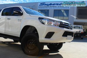 Front end of a white dual cab Toyota Hilux Revo fitted with a complete 3 inch Superior Nitro Gas lift kit