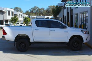 Right side view of the white dual cab Toyota Hilux Revo fitted with a complete 3 inch Superior Nitro Gas lift kit at the Deception Bay 4x4 showroom