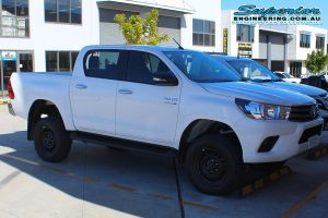 Front right view of the white dual cab Toyota Hilux Revo fitted with a complete 3 inch Superior Nitro Gas lift kit at the Deception Bay 4x4 fitting workshop