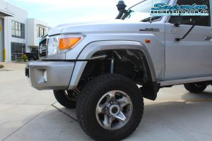 Closeup view of a single Superior remote reservoir shock fitted to the front of the 79 Series Toyota Landcruiser