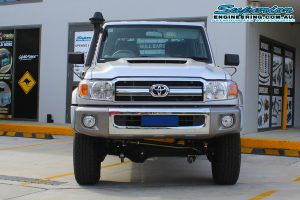 Front view of a dual cab 79 Series Toyota Landcruiser after fitting a Superior Remote Reservoir Superflex Lift Kit at the Superior 4x4 retail showroom