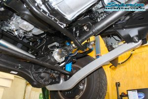 Closeup view of a single Superior radius arm and swaybar extension fitted to the front of the 79 Series Toyota Landcruiser