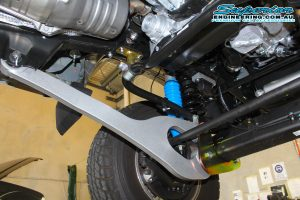 Closeup view of a single Superior Superflex radius arm, shock, coil and swaybar extension fitted to the front of the 79 Series Toyota Landcruiser