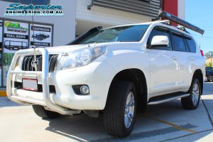 Front left view of a white 150 Prado after fitting the 2 inch Bilstein lift kit at the Superior Engineering 4WD fitting workshop