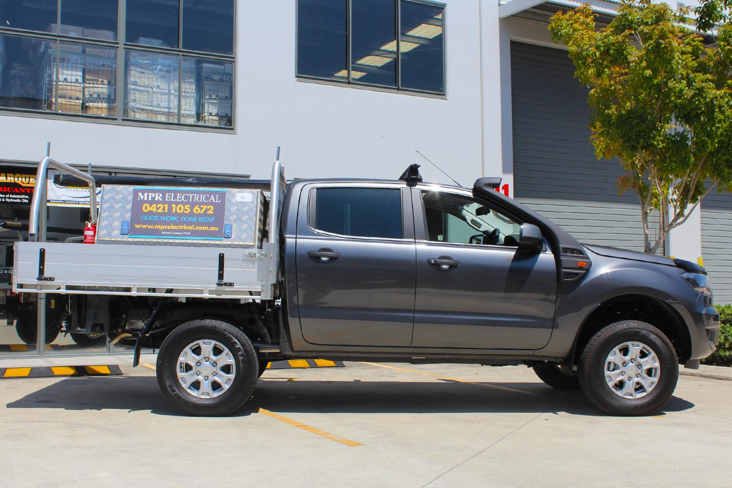 Right side view of a grey Dual Cab PX Ford Ranger fitted with a heavy duty 40mm Tough Dog lift kit at the Superior Engineering Deception Bay 4x4 store