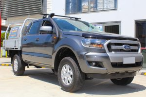 Front right view of a grey Dual Cab PX Ford Ranger fitted with a heavy duty 40mm Tough Dog lift kit at the Superior Engineering Deception Bay 4x4 store