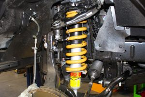 Closeup view of a single Tough Dog shock and coil spring fitted to the front of a PX Ford Ranger