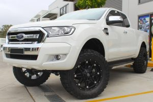 Front left view of a white extra cab Ford Ranger fitted with a heavy duty 3 inch Nitro Gas lift kit from Superior Engineering