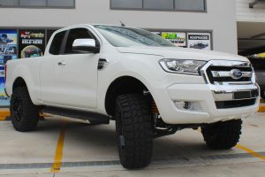 Front right view of a white extra cab PX Ford Ranger fitted with a heavy duty 3 inch Nitro Gas lift kit from Superior Engineering