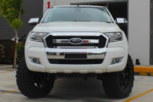 Front view of a white extra cab PX Ford Ranger fitted with a heavy duty 3 inch Nitro Gas lift kit at the Superior Engineering Deception Bay 4x4 store