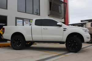 Right side view of a white extra cab PX Ford Ranger fitted with a heavy duty 3 inch Nitro Gas lift kit at the Superior Engineering Deception Bay 4x4 store