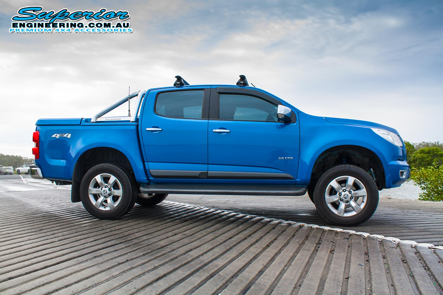 Right side view of a blue Holden Colorado RG Dual Cab fitted with a 4 Inch Premium Superior Engineering lift kit
