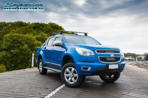 Front right view of a blue Holden Colorado RG Dual Cab fitted with a 4 Inch Premium Superior Engineering lift kit at the Burpengary boat ramp