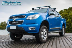 Front left view of a blue Holden Colorado RG Dual Cab fitted with a 4 Inch Premium Superior Engineering lift kit