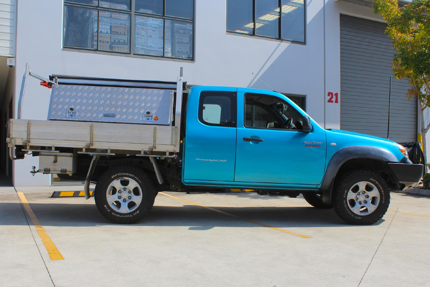 Right side view of a blue Mazda BT-50 extra cab fitted with a premium 35mm Bilstein lift kit from Superior Engineering