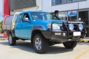 Front right view of a blue extra cab Mazda BT-50 fitted with a premium 35mm Bilstein lift kit at the Superior Engineering Deception Bay 4x4 showroom