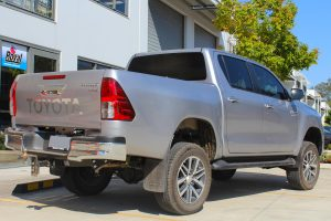 Rear right end view of a silver Toyota Hilux Revo (dual cab) fitted with a range of premium four wheel drive suspension components at the Superior Engineering Deception Bay 4x4 showroom