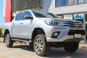 Front right view of a silver Toyota Hilux Revo (dual cab) fitted with a range of premium four wheel drive suspension components at the Superior Engineering Deception Bay 4x4 showroom
