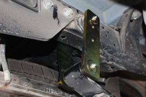 Closeup view of a single Superior Greaseable Shackle fitted to the Toyota Hilux Revo chassis and leaf spring