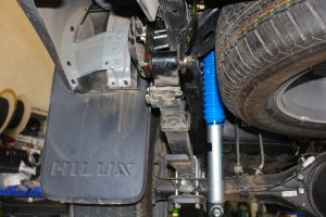 Closeup view of a single Superior Nitro gas shock and Greaseable Shackle fitted to the Toyota Hilux Revo