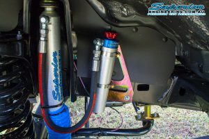 Closeup view of a Superior shock and remote reservoir canister mounted to a remote res mount fitted to the front of a 79 Series Toyota Landcruiser Dual Cab