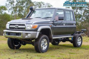 Front left view of a dual cab 79 Series Toyota Landcruiser after fitting a 4 inch Superior Remote Reservoir Superflex Lift Kit at the main Superior Engineering Burpengary warehouse