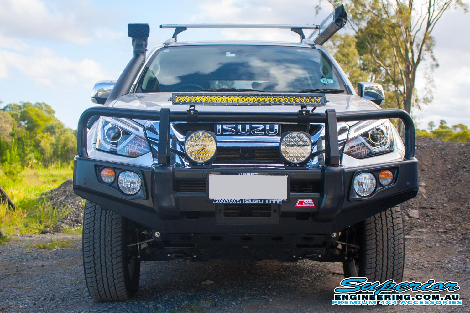 Front view of a silver Isuzu MU-X wagon fitted with a range of Lightforce, Ironman, MCC4x4, TJM 4x4 accessories and a heavy duty 45mm EFS lift kit