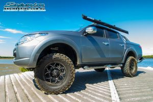 Left view of a MQ Mitsubishi Triton fitted with a set of Premium Superior Remote Reservoir Shocks and Struts at the Uhlmann road boat ramp