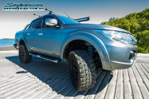 Front right view of a MQ Mitsubishi Triton fitted with some Premium Superior Remote Reservoir Shocks and Struts