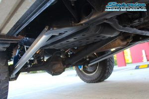 Closeup under vehicle view of the HyperFlex kit setup showing the superior long arms