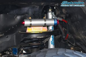 Closeup view of the HyperFlex kit setup showing a single remote res shock and res mount