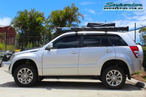 Left side view of a silver suzuki grand vitara wagon fitted with a 40mm Dobinson lift kit at the Superior 4x4 retail showroom