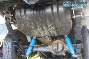 Closeup view of a set of heavy duty EFS leaf springs fitted to the rear of the 79 Series Landcruiser while on the hoist