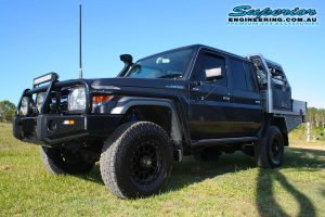 Front left view of a grey dual cab 79 Series Toyota Landcruiser after fitting the 2 inch Superior Nitro Gas Lift Kit + Allied Wheels