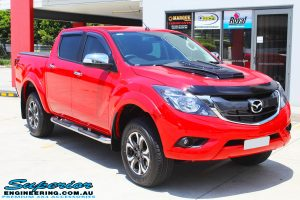 "Right front side view of a Red Mazda BT50 Dual Cab before fitment of a Superior Nitro Gas 2"" Inch Lift Kit, Legendex 3"" Exhaust + Heaps of Accessories"