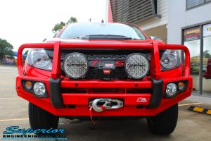 Front on view of a Red Mazda BT50 Dual Cab after fitment of Lightforce LED Driving Lights, Warn Winch, MCC 4x4 Bullbar + Heaps of Accessories