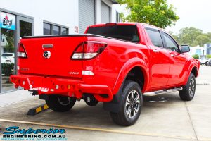 "Rear right view of a Red Mazda BT50 Dual Cab after fitment of a Superior Nitro Gas 2"" Inch Lift Kit, Towbar and EFS Rear Bar"