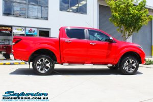 "Side view of a Red Mazda BT50 Dual Cab before fitment of a Superior Nitro Gas 2"" Inch Lift Kit, Legendex 3"" Exhaust + Heaps of Accessories"