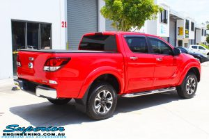 """Rear right view of a Red Mazda BT50 Dual Cab before fitment of a Superior Nitro Gas 2"""" Inch Lift Kit, Legendex 3"""" Exhaust + Heaps of Accessories"""