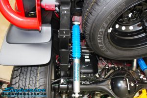 Left rear underbody view of a fitted Superior Nitro Gas Shock with Leaf Spring