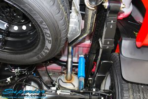 """Right rear underbody view of a fitted Superior Nitro Gas Shock, Leaf Spring and Legendex 3"""" Exhaust System"""