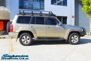 "Side view of a Gold Nissan GU Patrol Wagon before fitting a 2"" inch lift with Dobinsons Coil Springs & Fox Shocks"