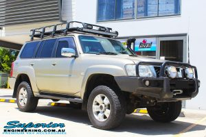 """Right front side view of a Gold Nissan GU Patrol Wagon after fitting a 2"""" inch lift with Dobinsons Coil Springs & Fox Shocks"""
