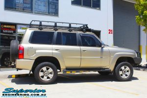 "Side view of a Gold Nissan GU Patrol Wagon after fitting a 2"" inch lift with Dobinsons Coil Springs & Fox Shocks"