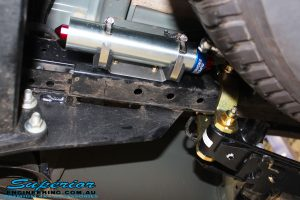 Right rear underbody view of a Superior Remote Reservoir Shock with Dobinson Leaf Spring