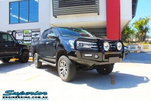 """Right front side view of a Black Toyota Hilux Revo after fitting a 2"""" inch lift with Dobinsons Coil & Leaf Springs with a Superior Remote Reservoir Rear Shock & Front Strut"""